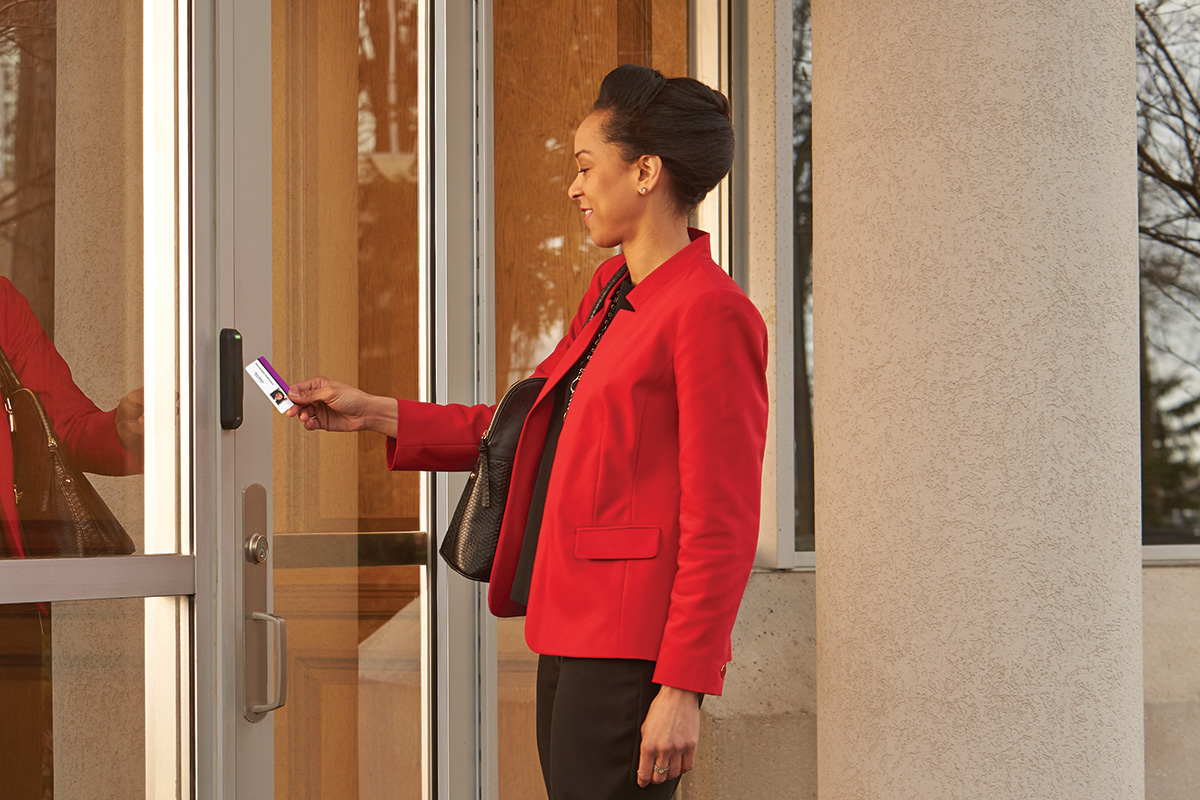 Photo of lady using a keycard on a card access device